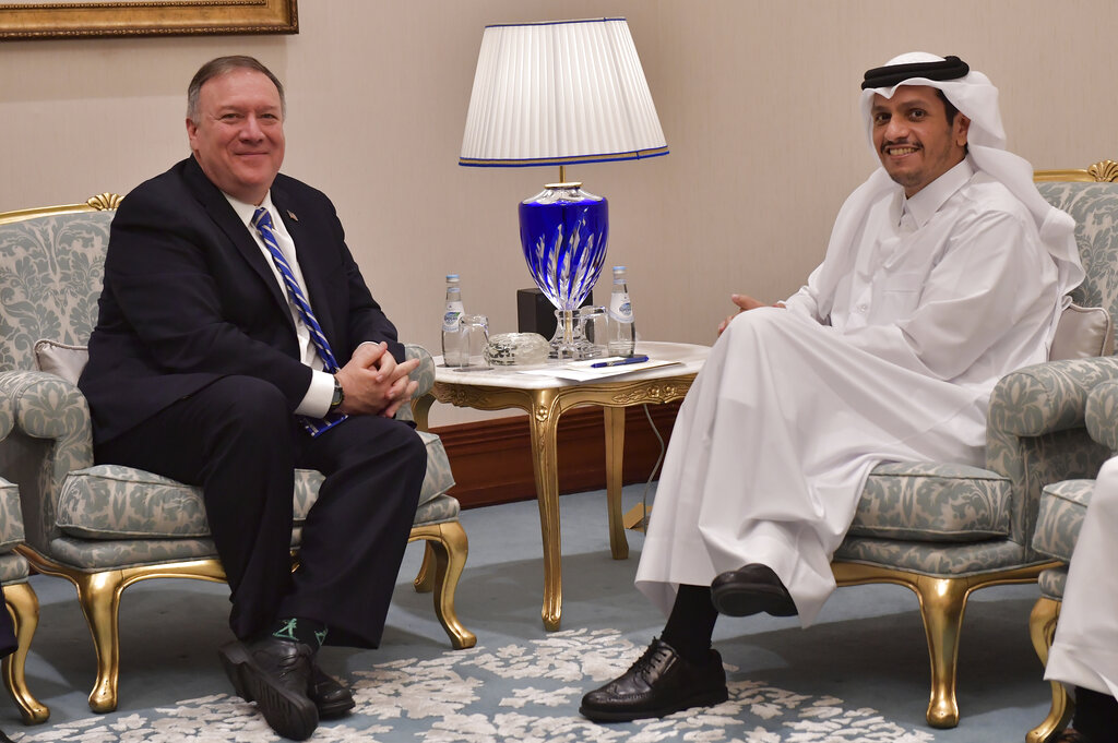 From left, U.S. Secretary of State Mike Pompeo meets with Qatar's Foreign Minister Sheikh Mohammed bin Abdulrahman Al Thani before a peace signing ceremony between the U.S. and the Taliban in Doha on Saturday, Feb. 29, 2020. The U.S. is poised to sign a peace agreement with Taliban militants on Saturday aimed at bringing an end to 18 years of bloodshed in Afghanistan and allowing U.S. troops to return home from America's longest war.