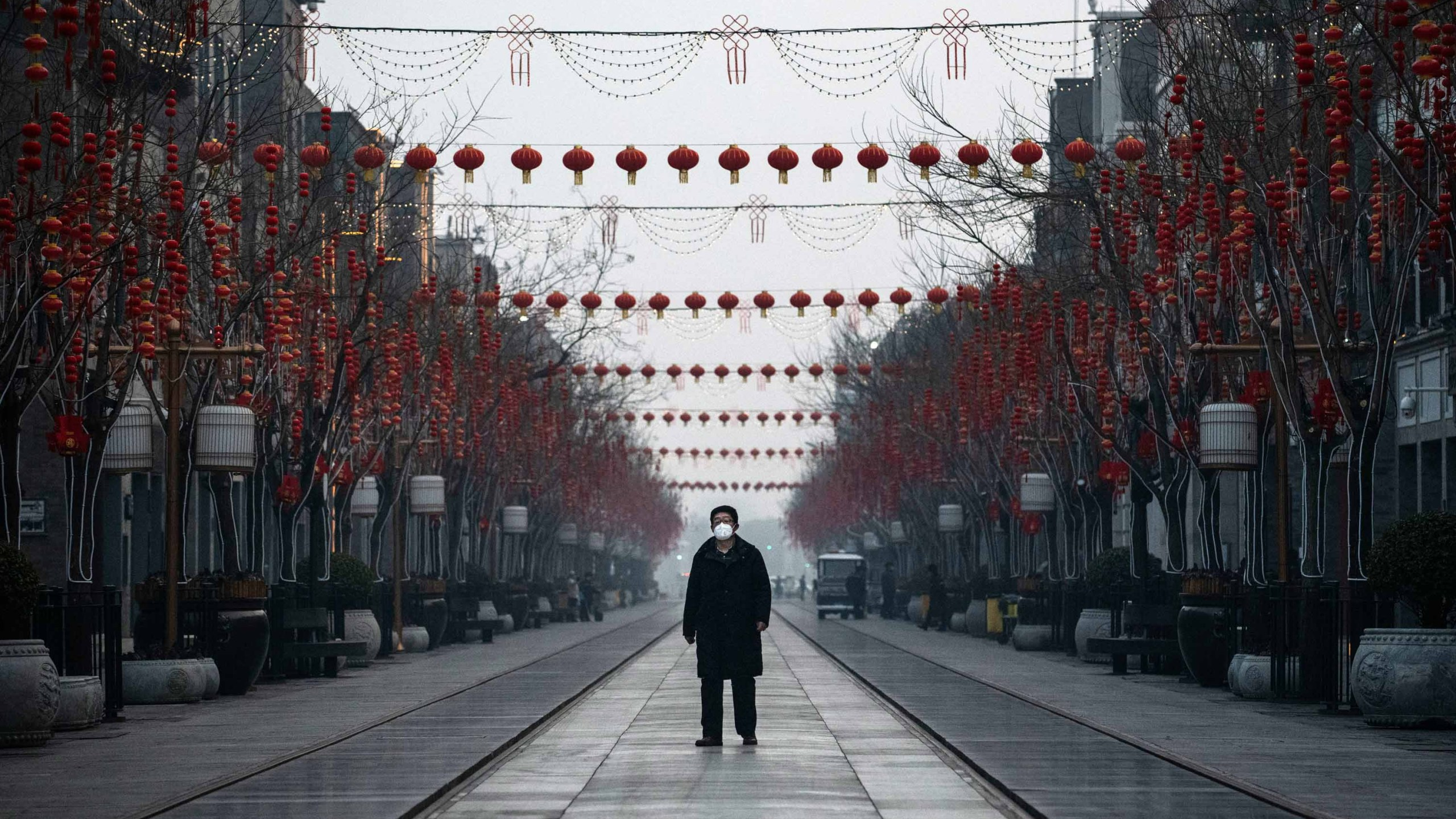BEIJING, CHINA - FEBRUARY 12: A Chinese man wears a protective mask as he walks in a nearly empty and shuttered commercial street on February 12, 2020 in Beijing, China. The number of cases of a deadly new coronavirus rose to more than 44000 in mainland China Wednesday, days after the World Health Organization (WHO) declared the outbreak a global public health emergency. China continued to lock down the city of Wuhan in an effort to contain the spread of the pneumonia-like disease which medicals experts have confirmed can be passed from human to human. In an unprecedented move, Chinese authorities have put travel restrictions on the city which is the epicentre of the virus and municipalities in other parts of the country affecting tens of millions of people. The number of those who have died from the virus in China climbed to over 1100 on Wednesday, mostly in Hubei province, and cases have been reported in other countries including the United States, Canada, Australia, Japan, South Korea, India, the United Kingdom, Germany, France and several others. The World Health Organization has warned all governments to be on alert and screening has been stepped up at airports around the world. Some countries, including the United States, have put restrictions on Chinese travellers entering and advised their citizens against travel to China