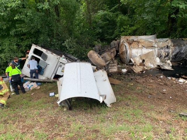 Asphalt truck overturns in Colbert County